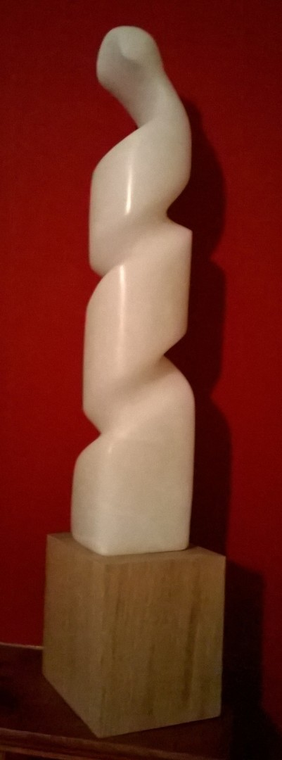 'Unfurling' stone carving in alabaster
